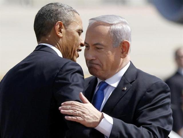 U.S. President Barack Obama hugs Israeli Prime Minister Benjamin Netanyahu at Ben Gurion International Airport Airport in Tel Aviv